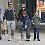 Ned Rocknroll and Kate Winslet held hands on a walk with her kids.