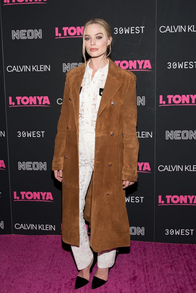 Margot wore a daring Calvin Klein ensemble consisting of sheer lace and a suede trench at the I, Tonya New York premiere in November 2017.