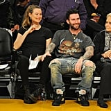 Expectant Parents Adam Levine and Behati Prinsloo Cuddle Up For a Sweet Date Night