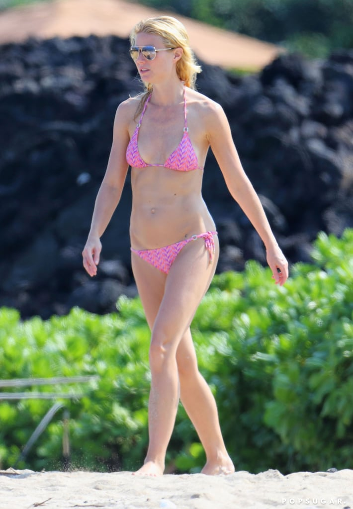 Gwyneth Paltrow showed off her figure in a bright pink bikini while vacationing with her family in Hawaii this week.