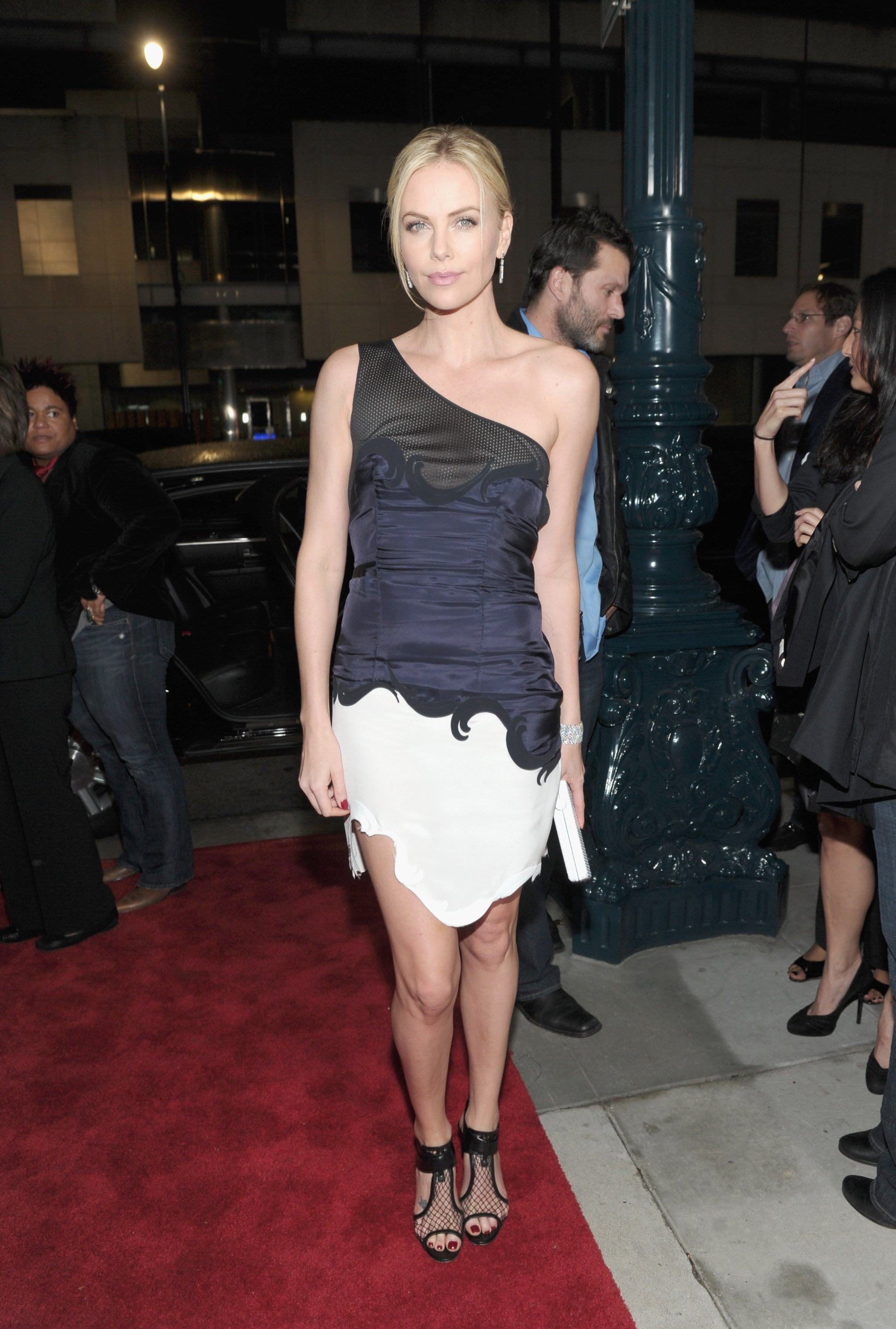 Charlize Theron in a colorblocked dress at the LA premiere of Young Adult.