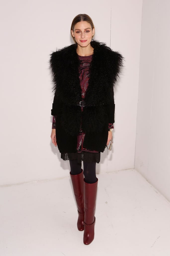 For Rachel Zoe's presentation, Olivia topped a printed dress with a furry vest.