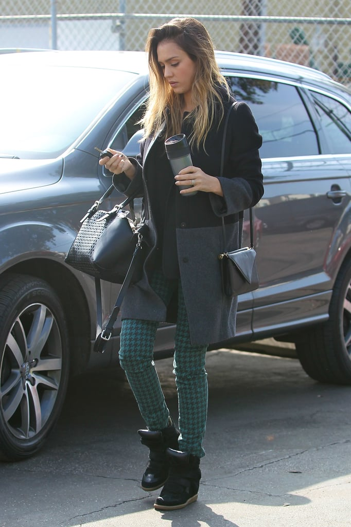 Jessica continued her reign as the print-jean queen, donning a pair of Big Star emerald houndstooth denim with a two-toned coat and cutout leather duffel, both by Gérard Darel, and Isabel Marant sneakers in LA.