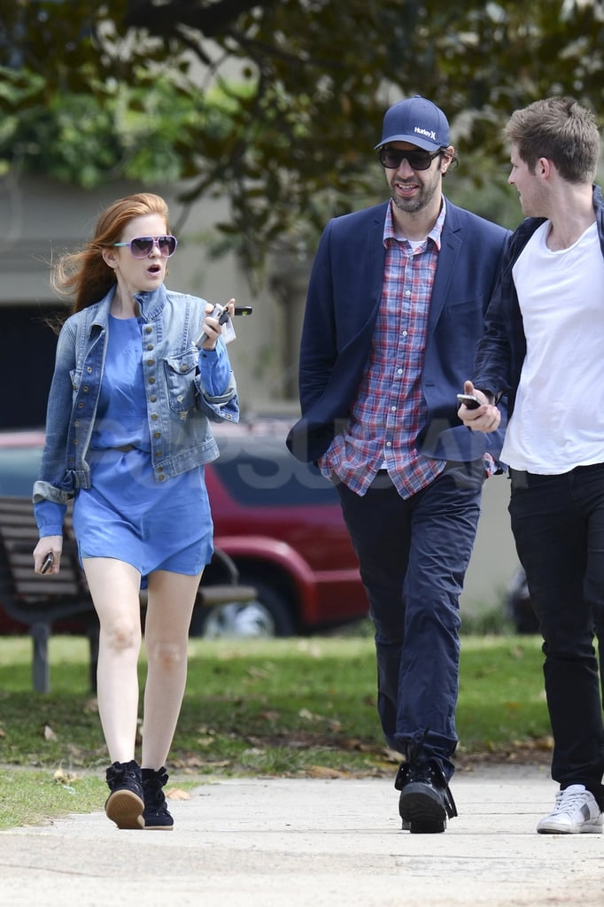 Isla Fisher and Sacha Baron Cohen walked with a friend in Australia.