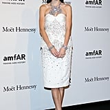 Jessica Stam opted for an ultraglam confection and a red lip for a night out at amfAR.