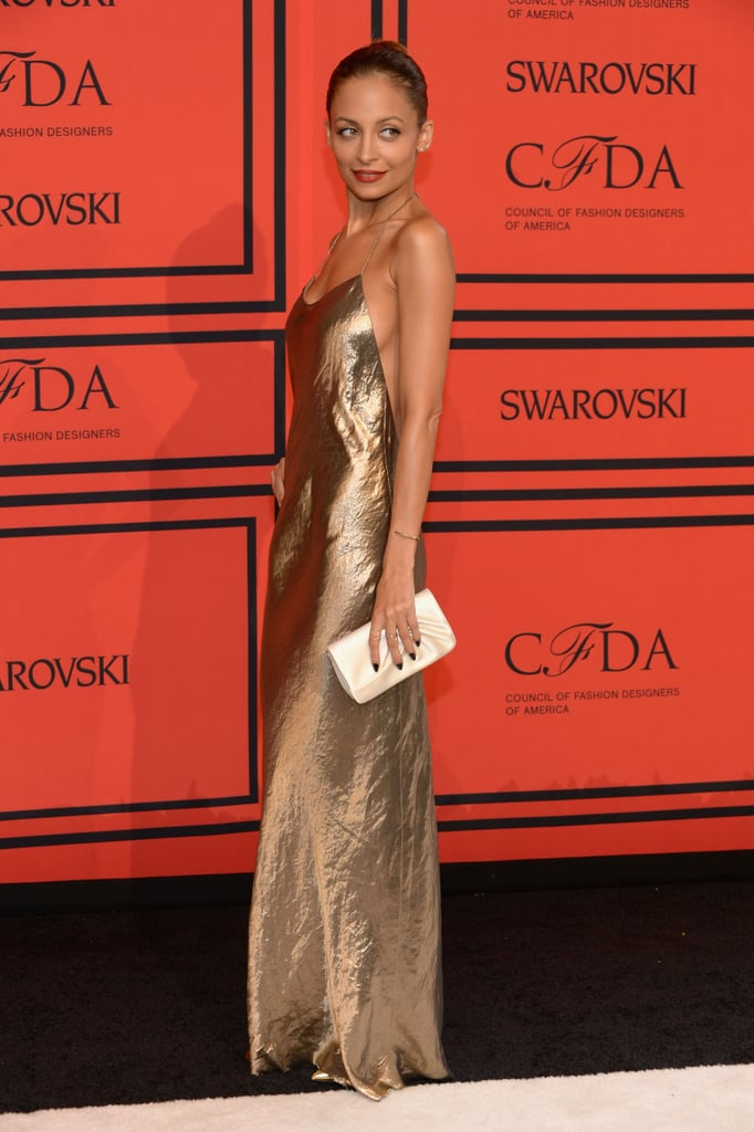 Nicole Richie walked the red carpet in a gold gown.