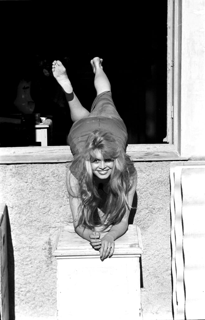 Brigitte Bardot struck a playful pose in 1957.