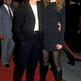 Nicole wearing an LBD, tights, and lace-up boots on the red carpet in 1993.