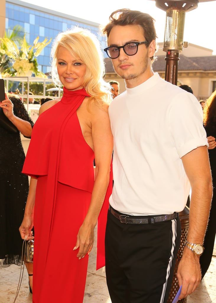 Pamela Anderson was in good company when she attended Sea Shepherd's 40th anniversary charity gala in LA on Saturday with her son, Brandon Lee. The pair made a seriously fierce duo as they made their way down the red carpet and Pamela couldn't help but beam while looking over at Brandon as they posed for pictures. The 21-year-old son of the former Baywatch actress and rocker Tommy Lee is already part of a famous family, but it's clear that he's starting to bust out on his own as a star in his own right. Not only has he already walked in several Dolce & Gabbana runway shows, but he's also starred in the brand's campaign and even attended the Met Gala for the first time ever this year. We can't wait to see what else Brandon has in store for 2017!