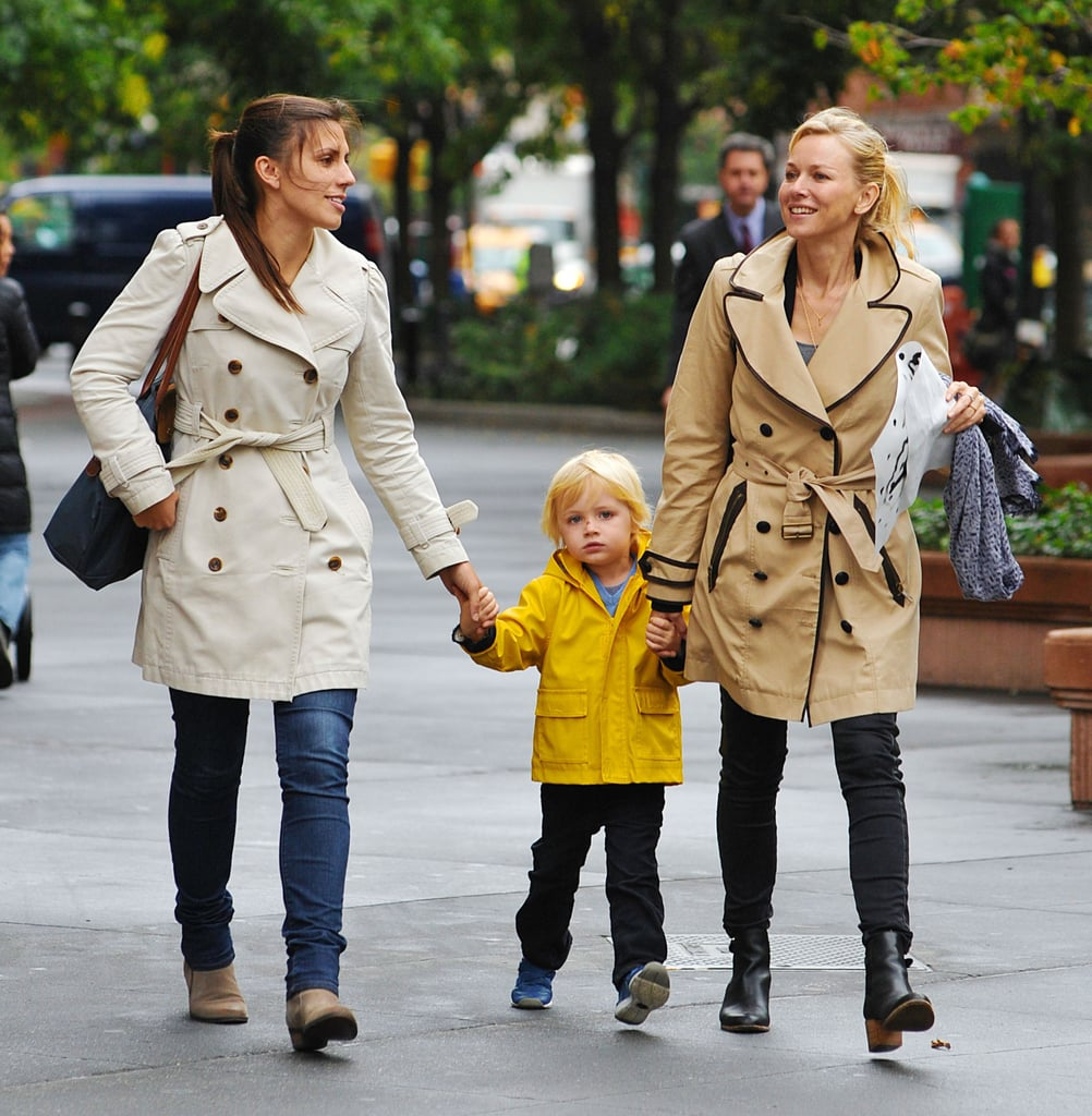Naomi Watts dressed her son Kai in some rain gear for a day out in NYC.