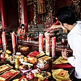 A man burned incense at the Satya Dharma Temple in Bali.