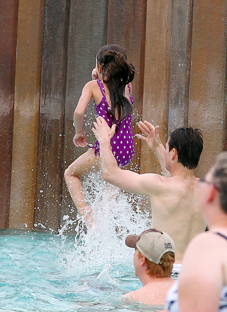 Suri Cruise and Tom Cruise played at a water park in Orlando.