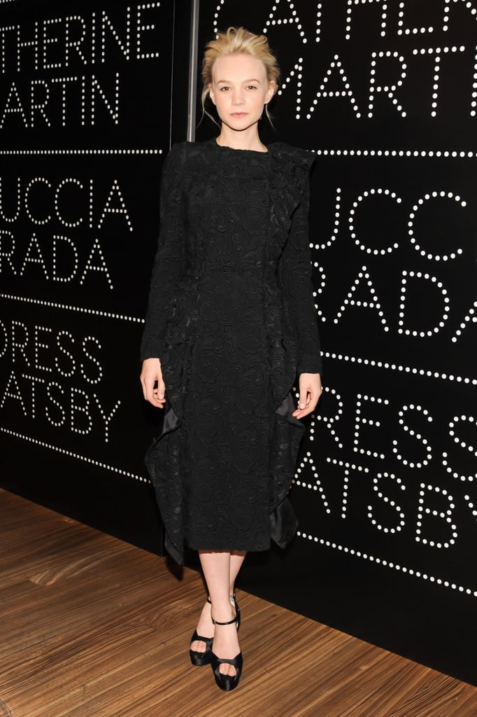 Leading lady Carey Mulligan donned an elegant black lace long-sleeved, ruffled-front coatdress at the Prada and The Great Gatsby party.