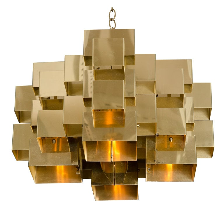 A true stunner, this Polished Brass Cubist Chandelier by Curtis Jere ($7,500) is from the '70s and signed by the designer. The brass plated steel chandelier has folded interlocking sections that form an intricate geometric cluster.