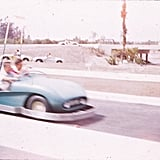 Guests raced by on Disneyland's Autopia attraction.