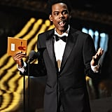 Chris Rock told jokes while presenting an award at the 2012 Oscars.