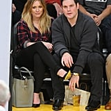 Hilary Duff and husband Mike Comrie sat in the front row at Thursday night's Laker game.