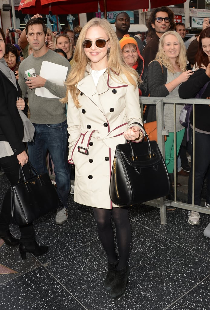 Amanda Seyfried channeled the classics in a trench coat and a luxe black tote in tow on the Hollywood Walk of Fame.