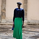 Though navy might technically be a colour, it acts as very much a neutrral when matched atop a brighter green hue.