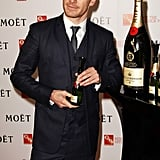 Michael posed with a bottle of Moét champagne.