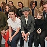 Brooklyn Beckham, Hana Cross, Cruz Beckham, Romeo Beckham, Harper Beckham, and David Beckham at Victoria Beckham Fall 2019