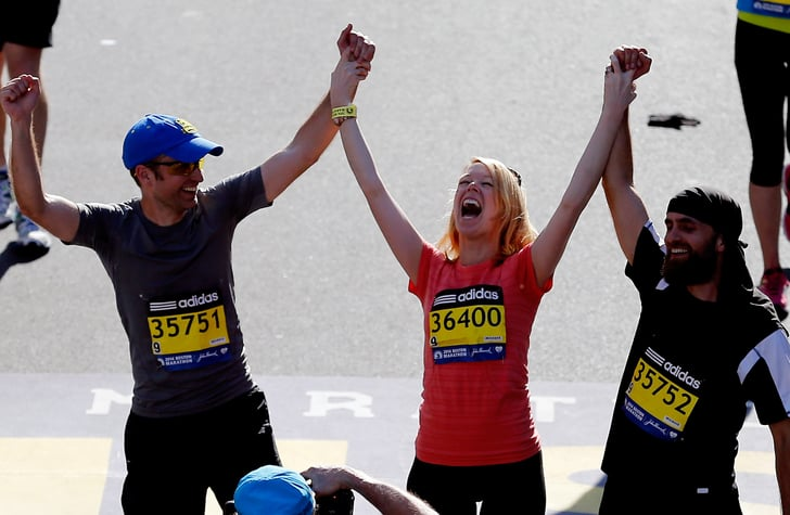 Boston Marathon bombing survivor Adrianne Haslet-Davis celebrated as she crossed the finish line one year later.