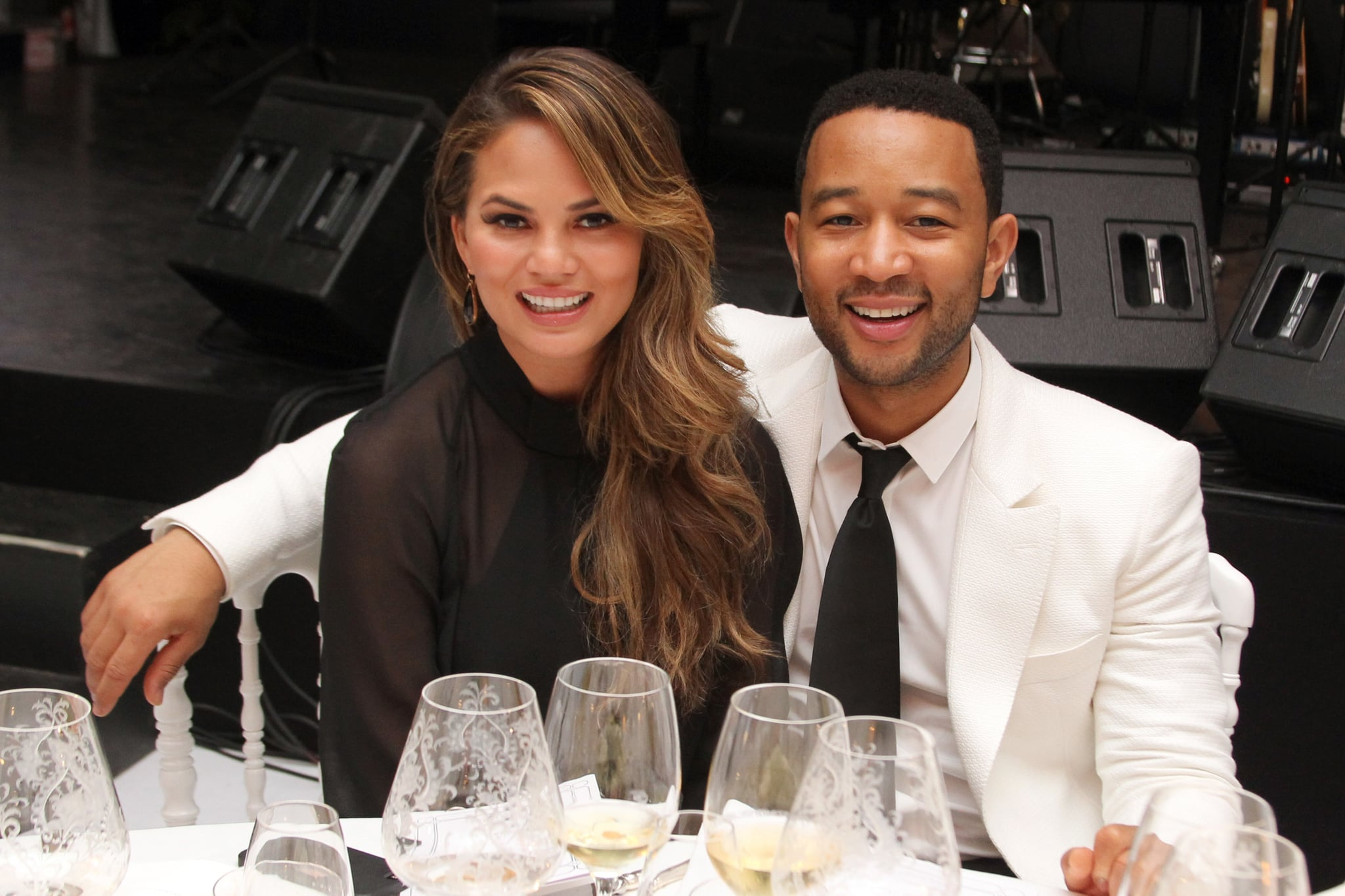 FLORENCE, ITALY - SEPTEMBER 05:  Chrissy Teigen and John Legend attend the White Party Dinner Hosted by Andrea and Veronica Bocelli Celebrating Celebrity Fight Night In Italy Benefitting The Andrea Bocelli Foundation and The Muhammad Ali Parkinson centre on September 5, 2014 at the Bocelli Residence in Forte dei Marme, Italy.  (Photo by Andrew Goodman/Getty Images for Celebrity Fight Night)