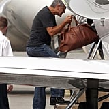 George Clooney boarded a private jet with Jennifer Aniston.