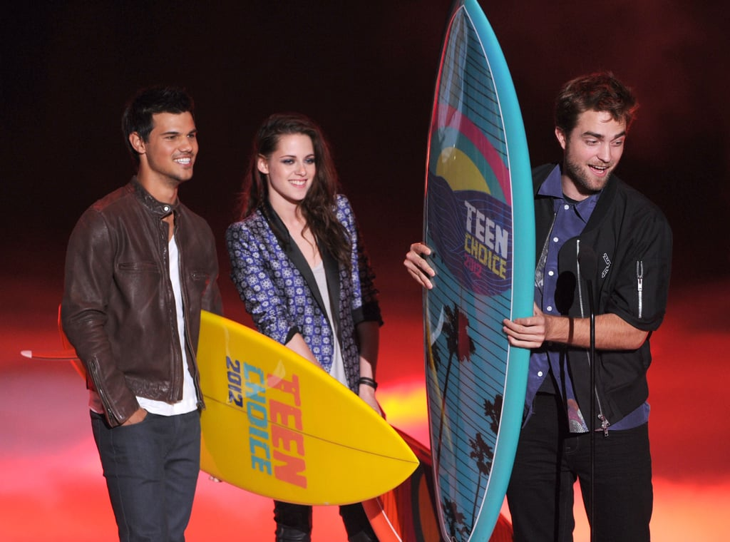 Taylor Lautner, Kristen Stewart and Robert Pattinson accepted surfboard trophies for their work in the Twilight movies.