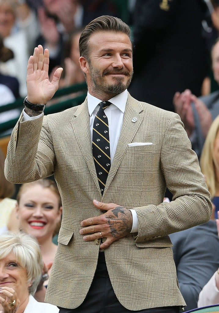 David Beckham looked dapper while watching a match at Wimbledon on Saturday.