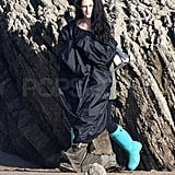 Kristen wore blue rain boots on the beach.