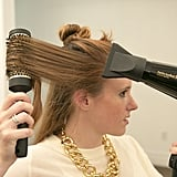 Make sure you smooth the hairline by blowing the section away from your face and wrapping it around the round brush. Halpin likes using a ceramic brush because it heats up while you blow-dry, which helps create waves. Source: Caroline Voagen Nelson