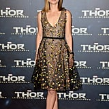 For the Paris premiere of Thor: The Dark World, Natalie Portman was feminine with a side of flirty in a floral-embellished fit-and-flare Dior Couture dress and gold, strappy Charlotte Olympia sandals.