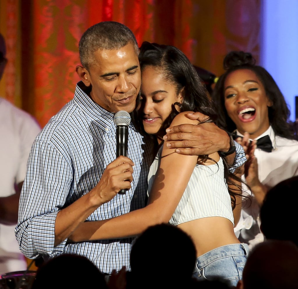 """After Malia Obama returned from a glamorous trip to Spain with her mom, grandmother, and sister last week, the eldest of the Obama daughters celebrated her 18th birthday on July 4 in spectacular fashion. Following a few exciting performances by Kendrick Lamar and Janelle Monáe at the White House's party, Malia got a surprise serenade from none other than her father, President Barack Obama. """"And just because it's a job of a father to embarrass his daughters, I've got one last job. It just so happens that we celebrate our country's birthday on the same day that we celebrate my oldest daughter's birthday,"""" Barack said while giving a speech to the crowd and leading them in singing """"Happy Birthday"""" to Malia. Looking stylish as always, she ran on stage so she could give her dad a hug. Keep reading to see the president's sweet moment with Malia, and then check out Sasha and Malia's cutest moments with their dad over the years!"""
