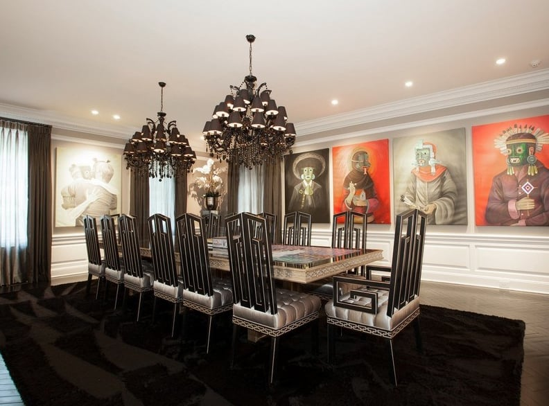 Large paintings and dark decor give the dining room a gothic ...
