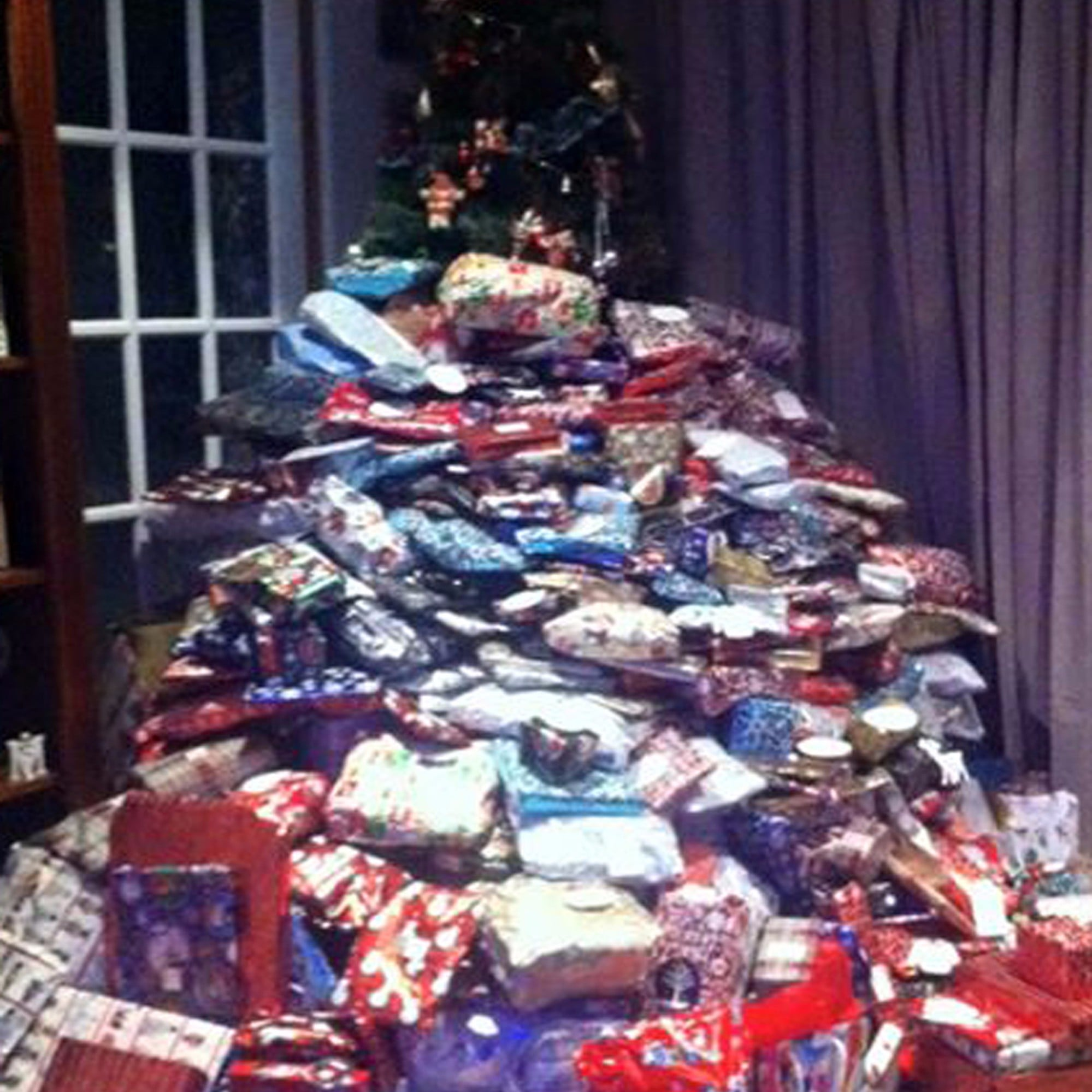 christmas presents stacked as tall as the christmas tree popsugar family - Christmas Presents