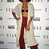 Sexy and funky: that's Solange's specialty. She sported high-waisted trousers in a flattering shade of red, paired with a pretty black bandeau and full-length knit sweater — making for a hot, bohemian-chic red-carpet look at the 2011 Elle Women in Music event in Hollywood.