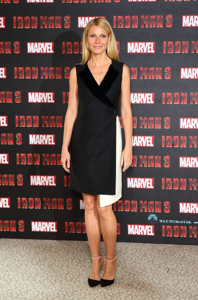 At the Iron Man 3 photocall in London, Gwyneth Paltrow was on-trend in a black-and-white Christian Dior wool dress with silk velvet detailing. She finished with two-tone ankle-strap pumps and minimal jewels.
