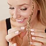 To make the braids look a bit bigger and looser, simply massage and gently tug at the plaits to expand them.