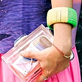 Even the most stylish showgoer remembers to bring (and show off) her USB cords!