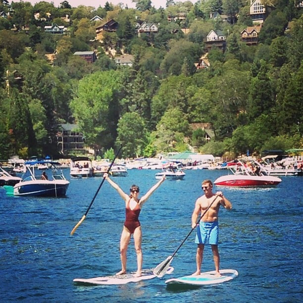 Talk about balance! That's Whitney Cummings getting in some stand-up paddleboard action with director Michael Patrick King.