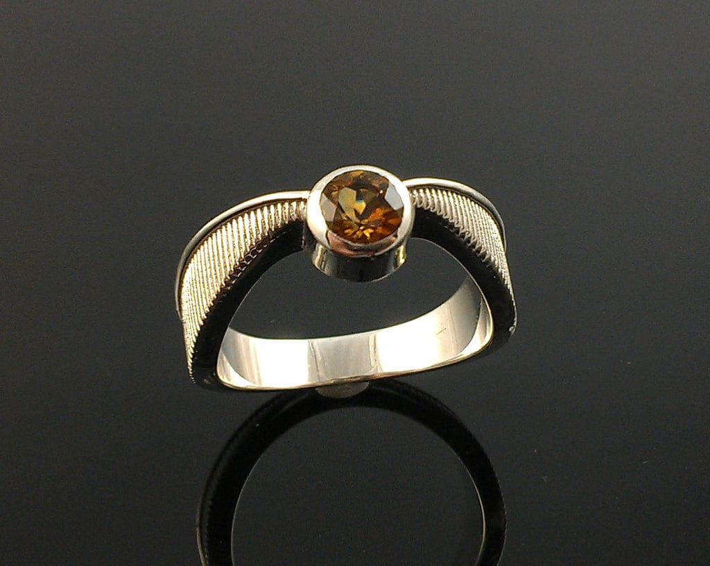 Flying Gold Ball Geeky Engagement Ring in Sterling Silver ($200)