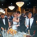 Jennifer planted a sweet smooch on her boyfriend, Nicholas Hoult, before heading to the stage to accept her best supporting actress award.