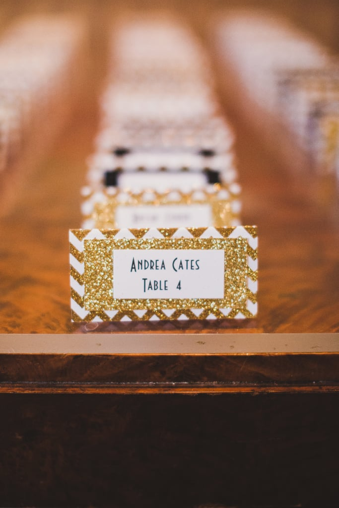 Organize place cards by table with different glittery colors.