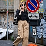 Give high-waist, wide-leg pants a Summer spin with comfortable sandals and a linen shirt.