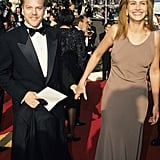 At the Oscars in 1990, Julia kept things simple in gold chandelier earrings and a taupe gown, which was pulled up to show off her suede pumps.