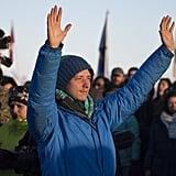 A protester raises his arms.