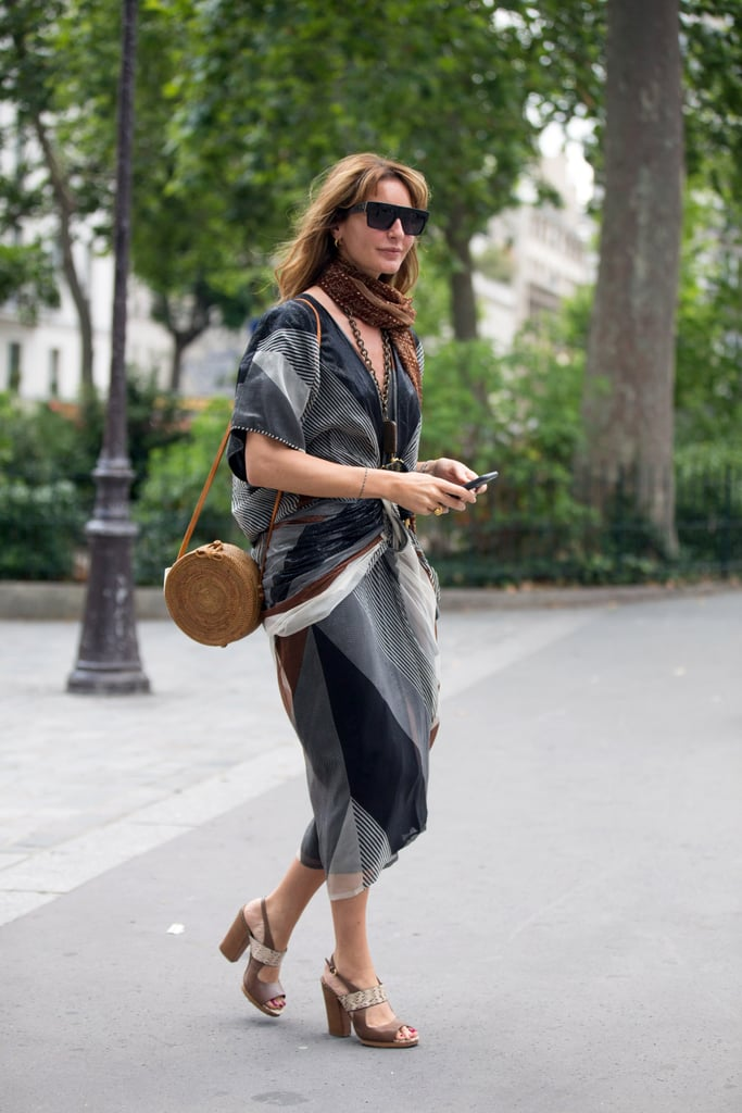 Opt for a circular bag, styled with loose fabrics and block heels.