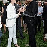 Anne Hathaway chatted with Jim Carrey at the Stella McCartney presentation in NYC.