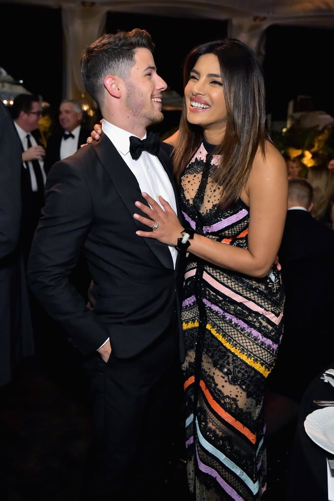 """It's OK everyone, Nick Jonas is in on the joke about his multiple weddings with Priyanka Chopra. After holding their fourth wedding reception in North Carolina last weekend, the newlyweds had a gorgeous date night at the Learning Lab Ventures 2019 Gala on Thursday. While Nick looked dapper in a tux, Priyanka looked absolutely stunning in a multicolored Elie Saab gown. The two just couldn't keep their hands off each other as Nick whispered in Priyanka's ear, and the Quantico actress cuddled up close to her husband.  Following their big night, Nick took to Instagram to poke a little fun at himself and the couple's many weddings. """"Walking into wedding reception 100047 like . . ."""" he captioned a photo of him and Priyanka walking down a staircase. """"Haha just kidding. So happy to celebrate our friends @armiehammer and @elizabethchambers and the amazing work they have done with @learninglabventures.""""       Related:                                                                                                           30 Times Priyanka Chopra and Nick Jonas Made Us Say, """"DAMN, They Look Good Together!"""""""